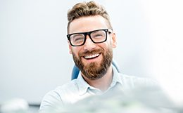 Male patient with beard and glasses waiting for oral surgery in St. Louis, MO